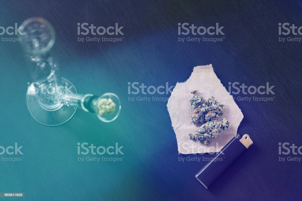 Bong and marijuana, cannabis thc flower Sativa and Indica Close up on a black background. lifestyle Concepts the legalization of marijuana in the world and the United States. Light toning - Royalty-free Addiction Stock Photo