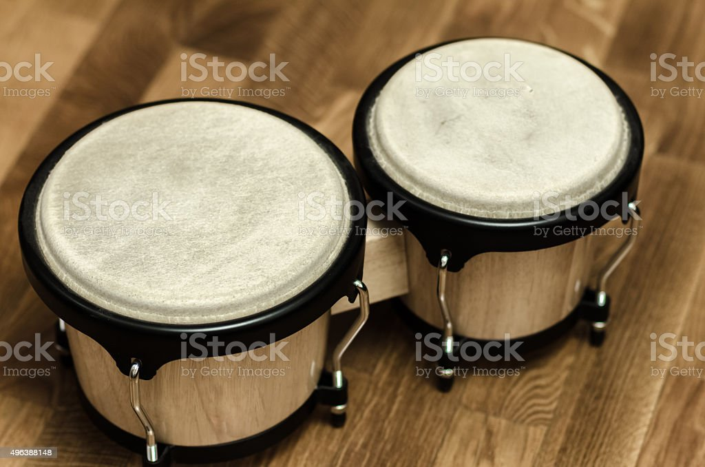 bongo drums at home wooden surface stock photo