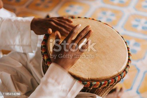 182677415 istock photo Bongos playing in Morocco, Africa. 1185414286