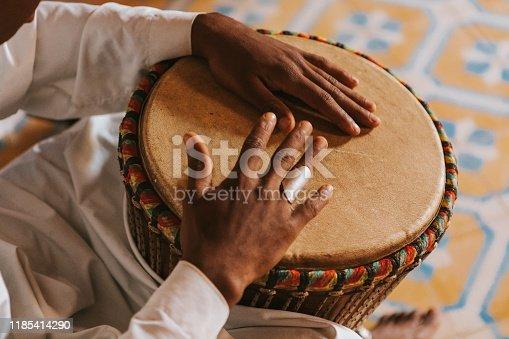 182677415 istock photo Bongos playing in Morocco, Africa. 1185414290