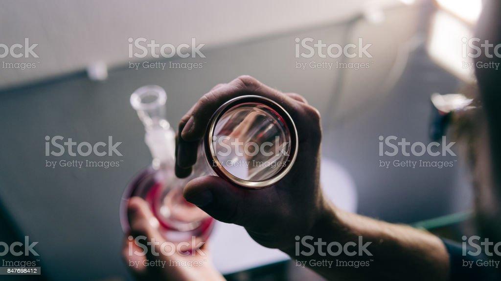bongs for smoking pot close-up soft focus. smoking culture of weed buds stock photo