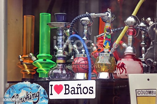 Baños de Agua Santa, Ecuador - November 11, 2014: A collection of bongs in store display window in the mountain town and major tourist center, Baños, Ecuador.