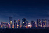 Night view of the commercial and residential district of Bonifacio Global City skyline in Taguig, Metro Manila, Philippines.