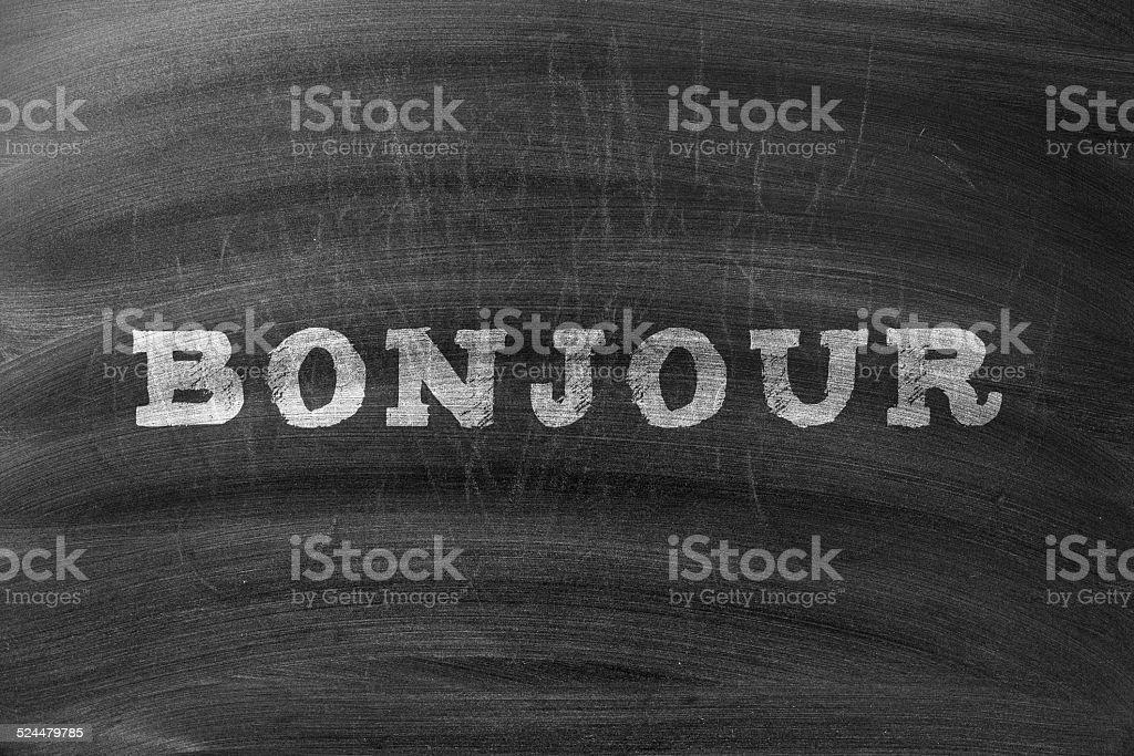Bonjour written on blackboard stock photo