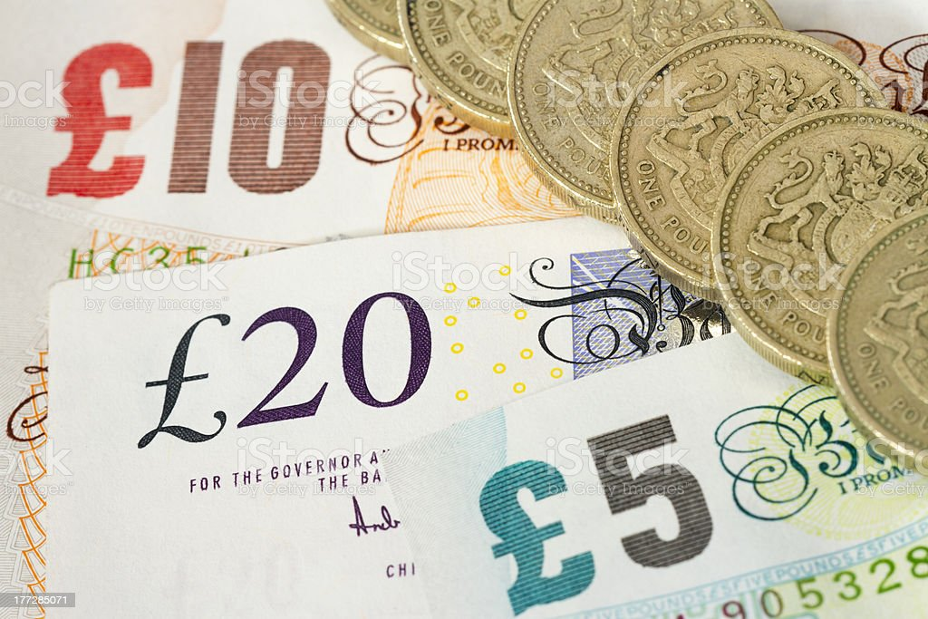 UK Bonknotes And One Pound Coins stock photo