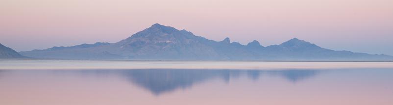 Bonneville Salt Flats Graham Peak Sunset Mountain Range Snow Mirage Stock Photo - Download Image Now