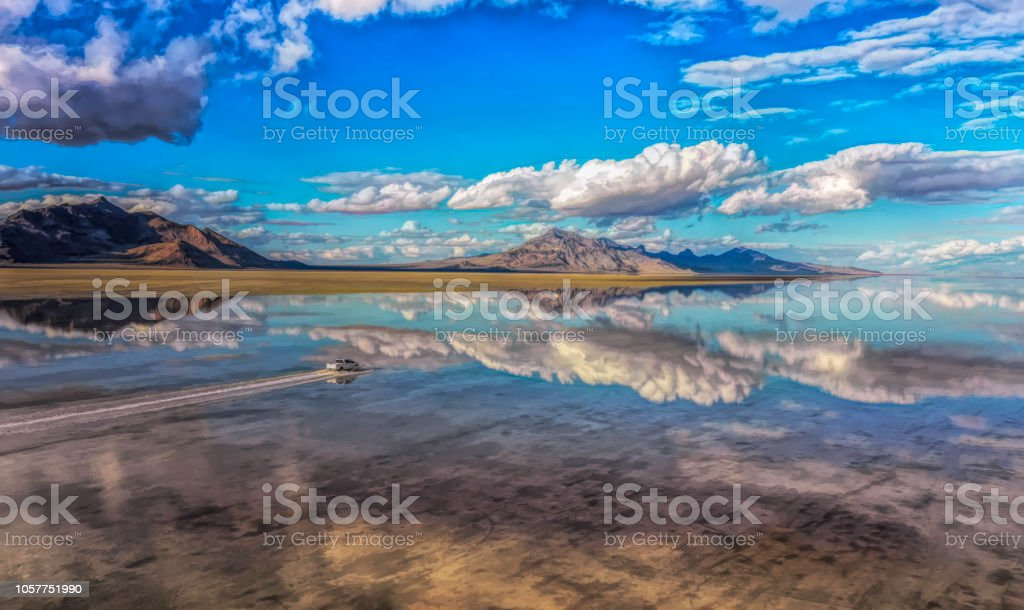 Bonneville Salt Flats reflecting in the shallow water stock photo