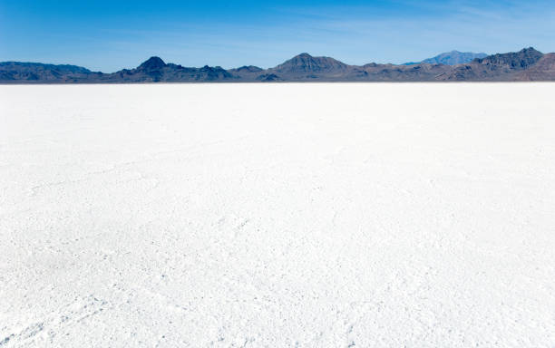 Bonneville Salt Flats with Mountains World famous Bonneville Salt Flats outside Salt Lake City Utah with mountains and blue skies bonneville salt flats stock pictures, royalty-free photos & images