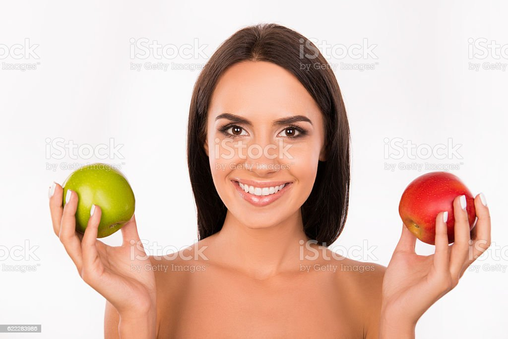 bonny girl chosing between green and red apples stock photo