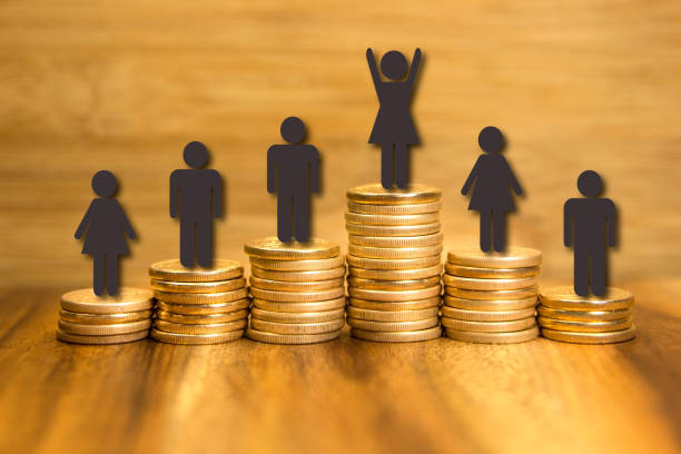 Bonus sales goal concept. Golden coins piles and first place woman winner. stock photo