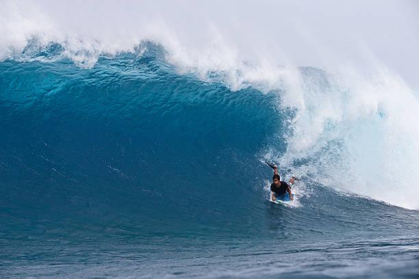 Boodyboarder on big wave stock photo