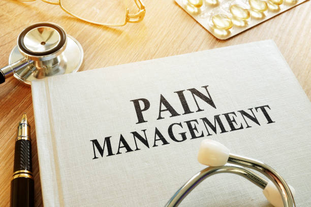 book about pain management. chronic care management concept. - dolore fisico foto e immagini stock