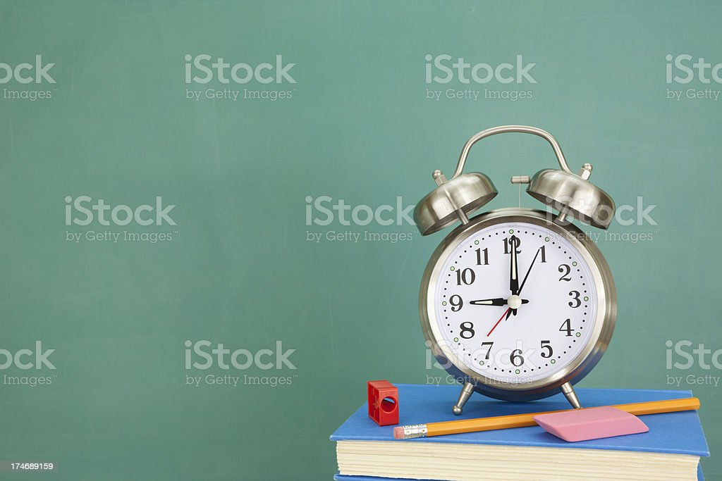 Book, Alarm Clock, and Chalkboard with Copy Space stock photo