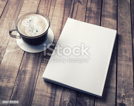 istock Book and coffee cup 699185858
