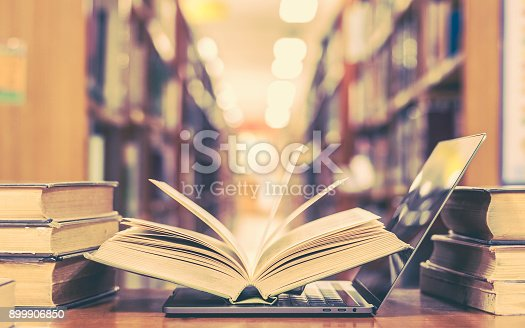 istock Book and computer technology in library 899906850