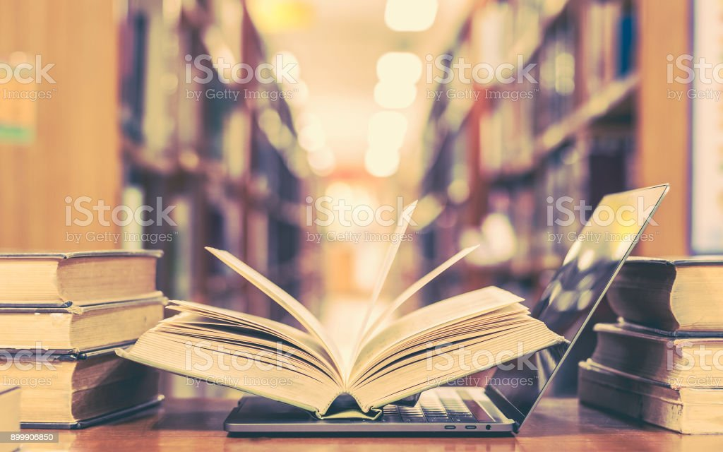 Book and computer technology in library stock photo