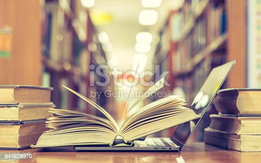 istock Book and computer technology in library 944629970