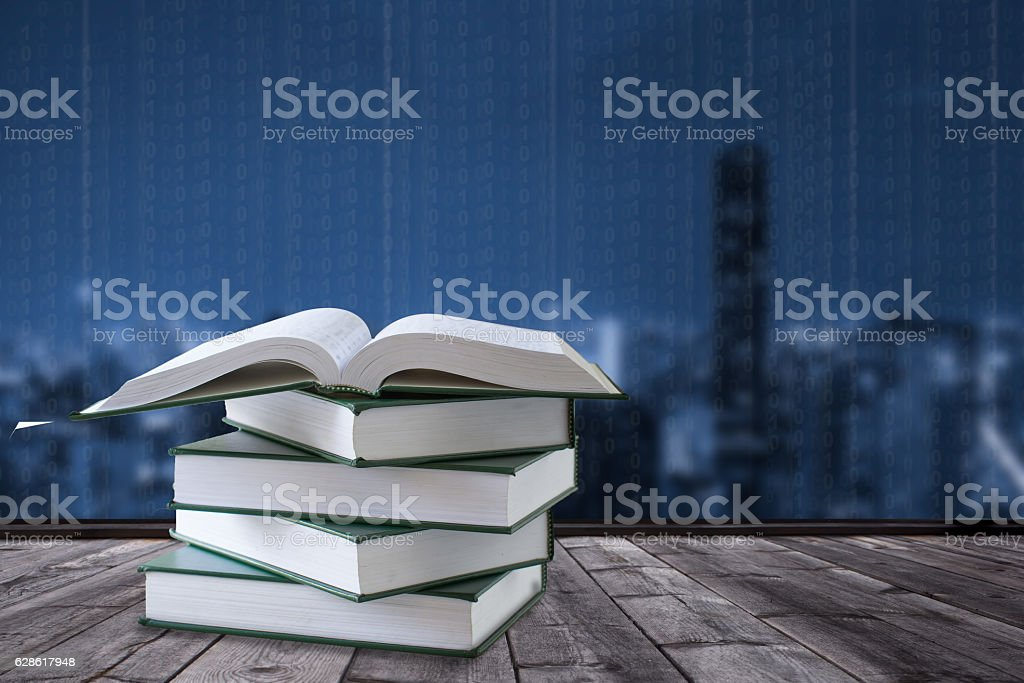 book and digital city background stock photo