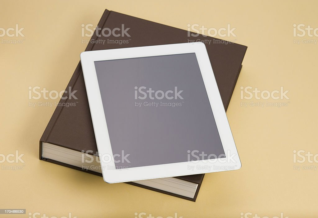 Book and Digital Tablet royalty-free stock photo