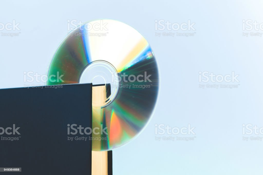 book and DVD disk stock photo