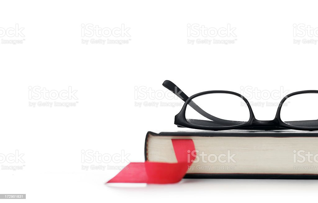 Book and eyeglasses stock photo