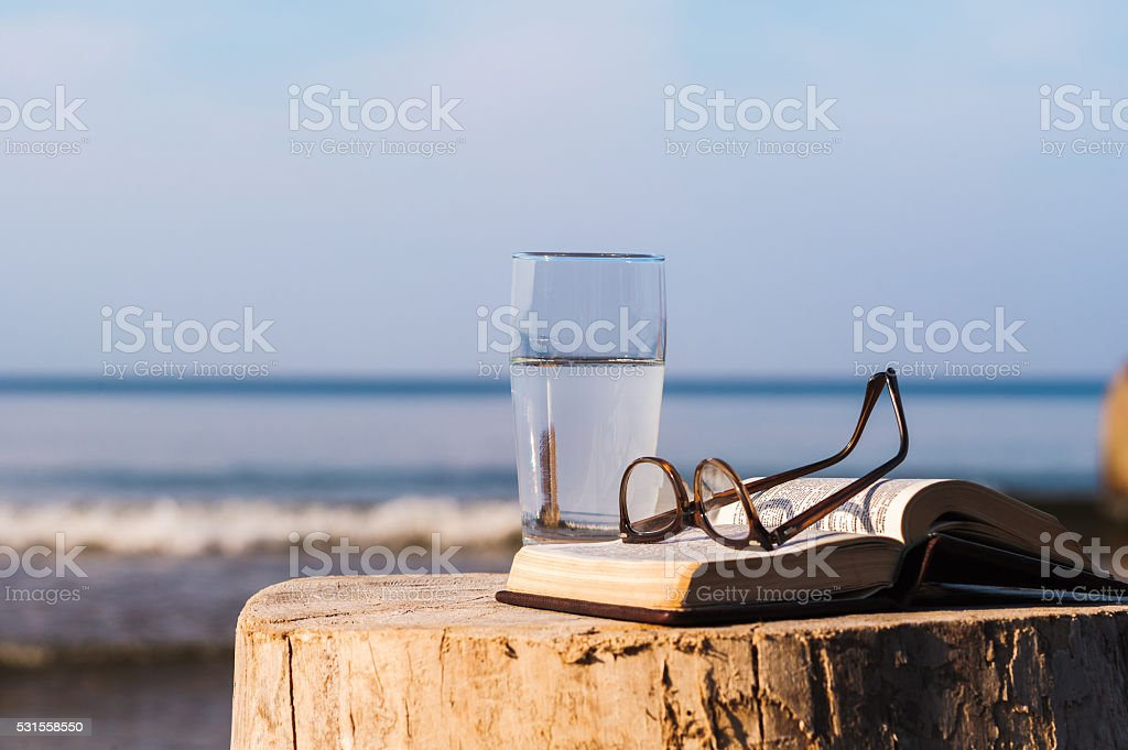 Book and glass stock photo