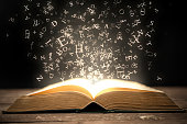 istock Book and glowing letters 522513933