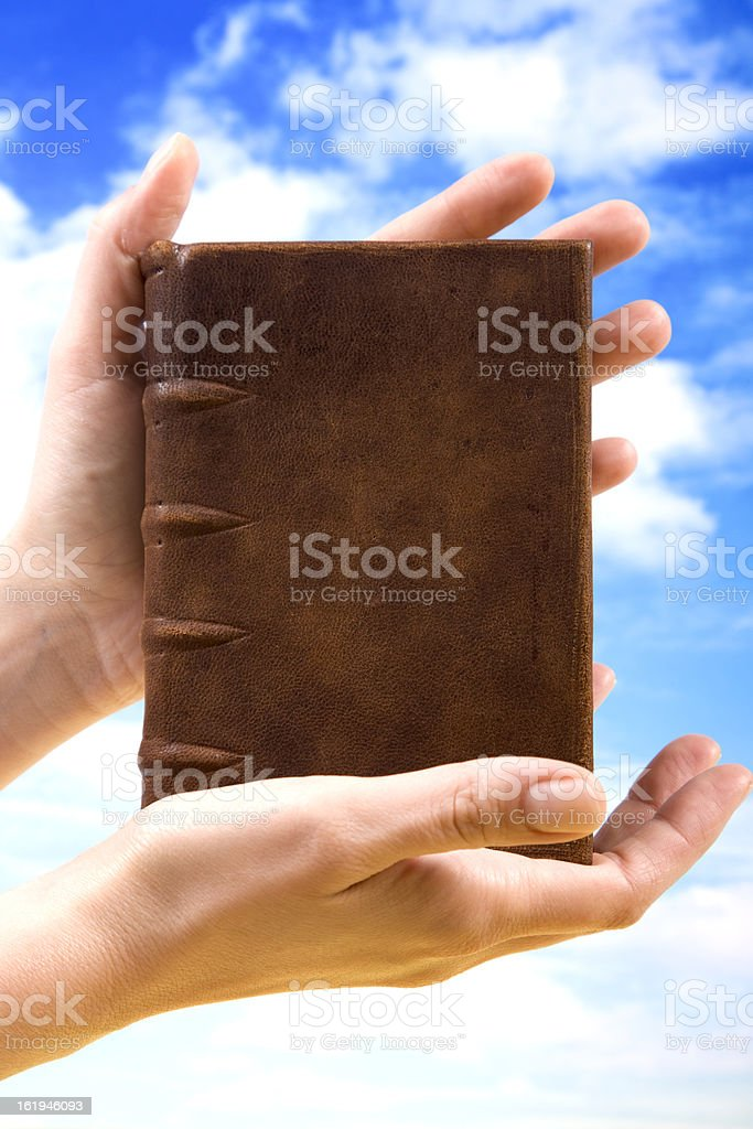 Book and hands royalty-free stock photo