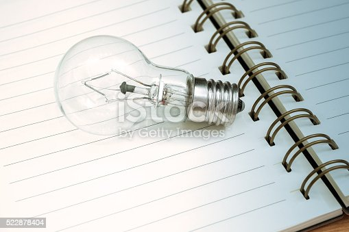 istock Book and light bulb 522878404