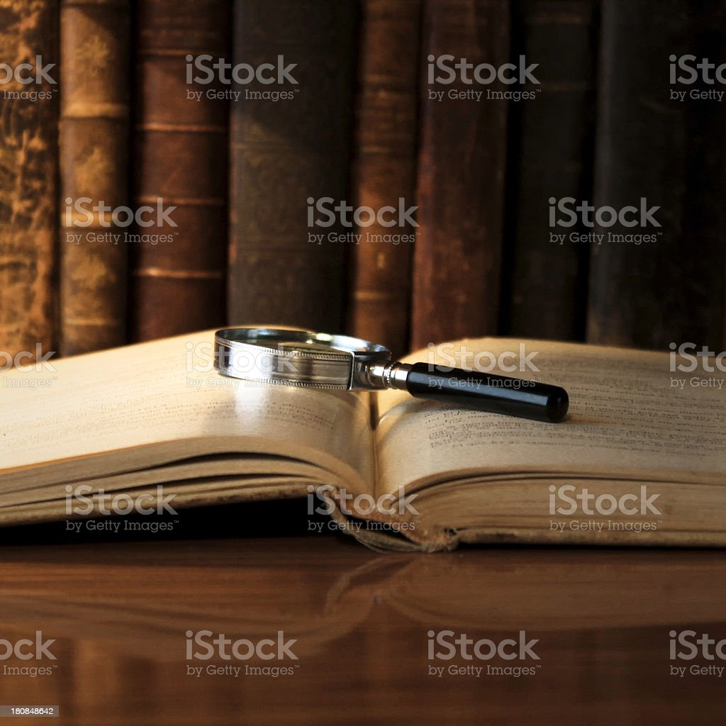 Book and mangifier royalty-free stock photo