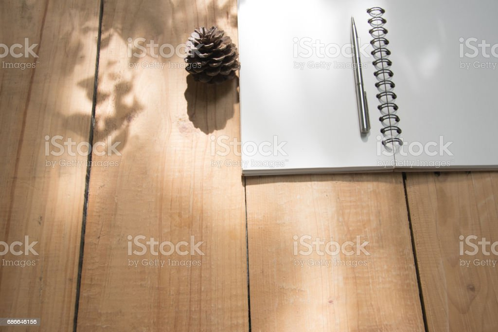 Book and pen on wooden table. top view angle. copy space royalty-free stock photo