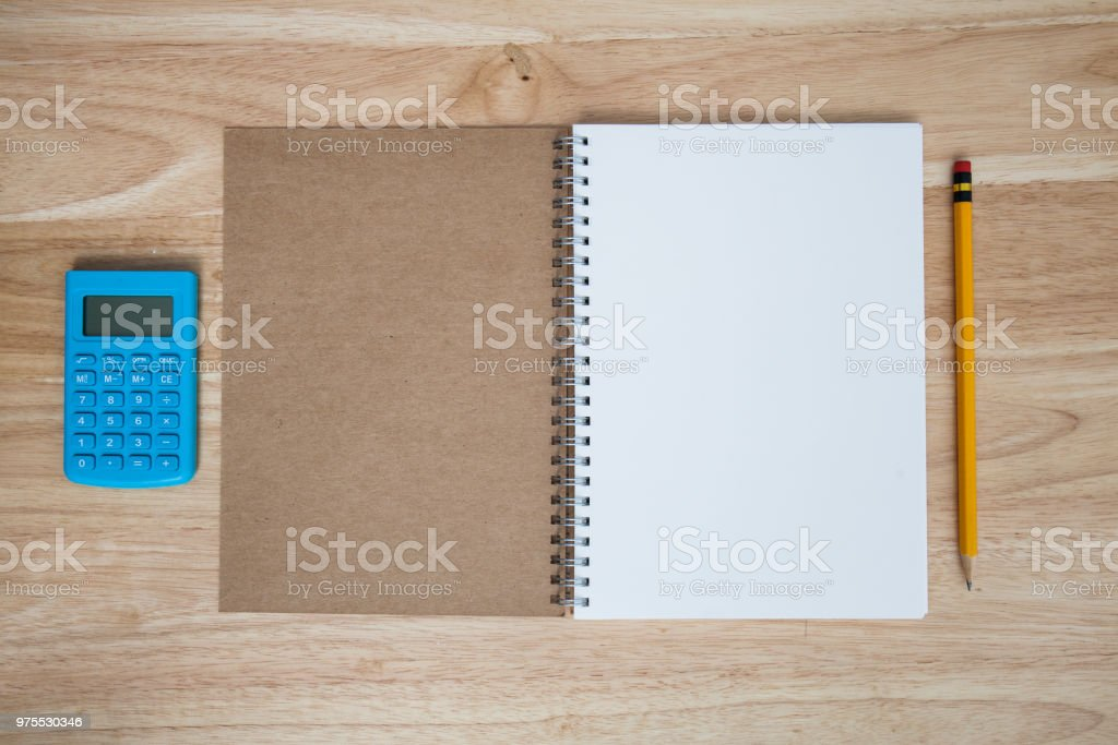 book and pencil and calculator stock photo