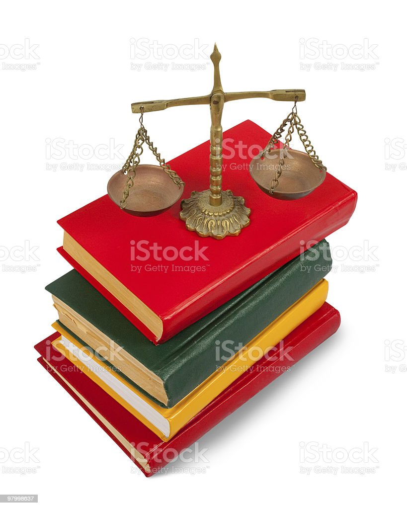 book and scales of justice over white background royalty-free stock photo