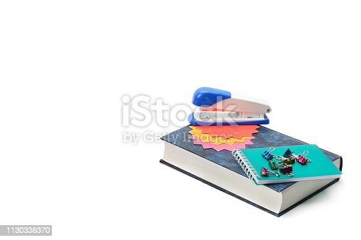 istock Book and stationery set isolated on a white background. 1130336370