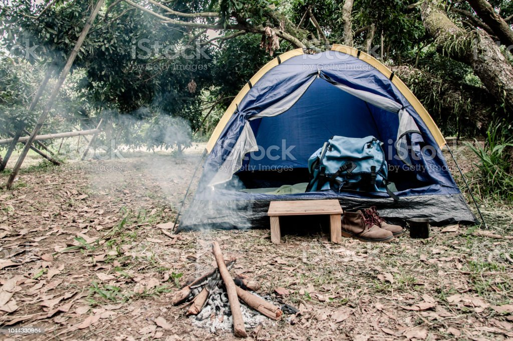 Book Bags And Camping Equipment Have Leather Shoes Outside The Tent Stock Photo Download Image Now Istock