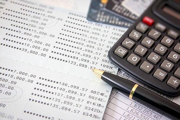 Book bank, credit cards, the calculator, a ball pen stock photo