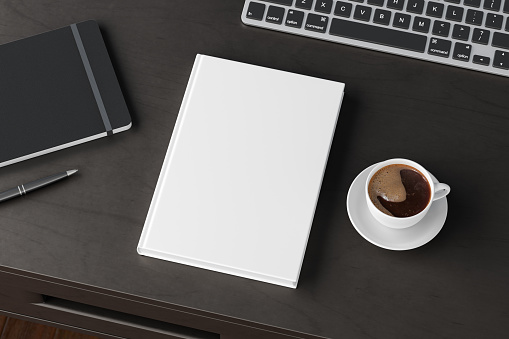 Book cover mock up. Workspace on wooden desk with cup of coffee