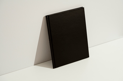 Yellow blank hardcover book mockup, template on white background.