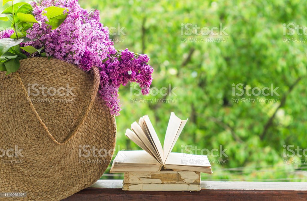 Book Cup Of Tea And Lilac On A Wooden Window Fragrant Tea In