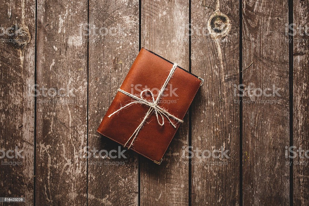 Gift book on wood background.