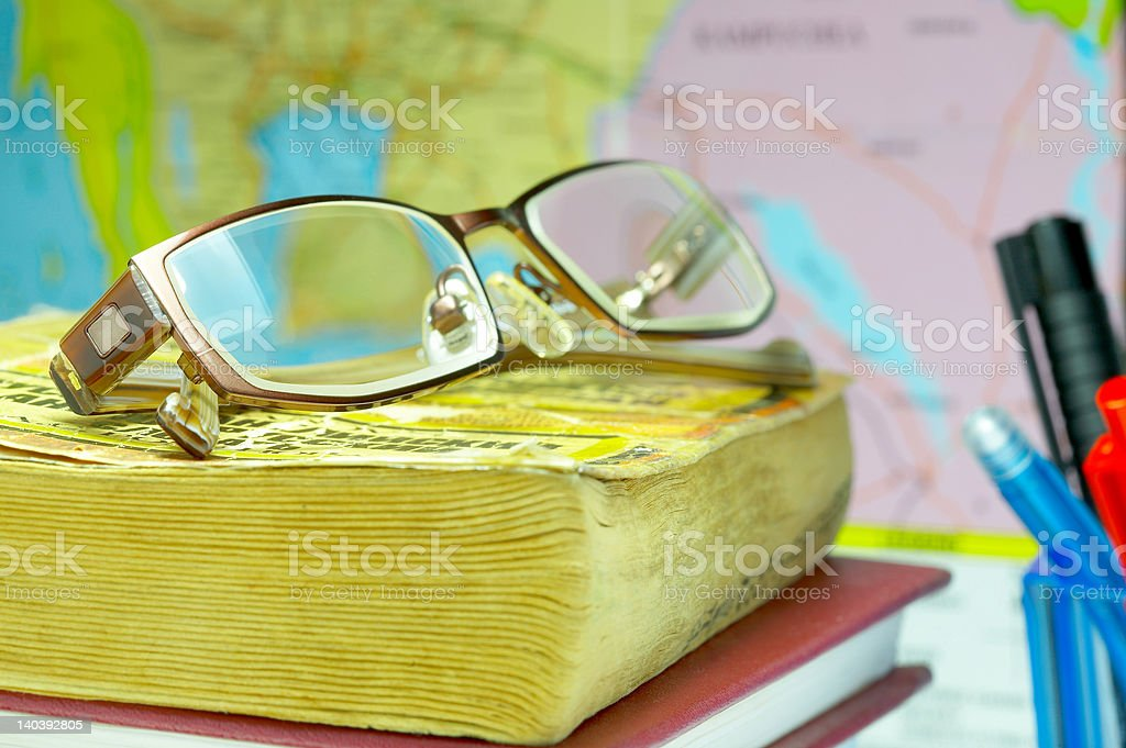 book, glasses and map royalty-free stock photo