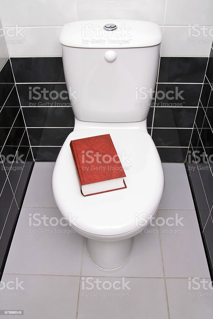 Book in the toilet royalty-free stock photo