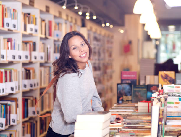 book lover at a book store - bookstore stock pictures, royalty-free photos & images