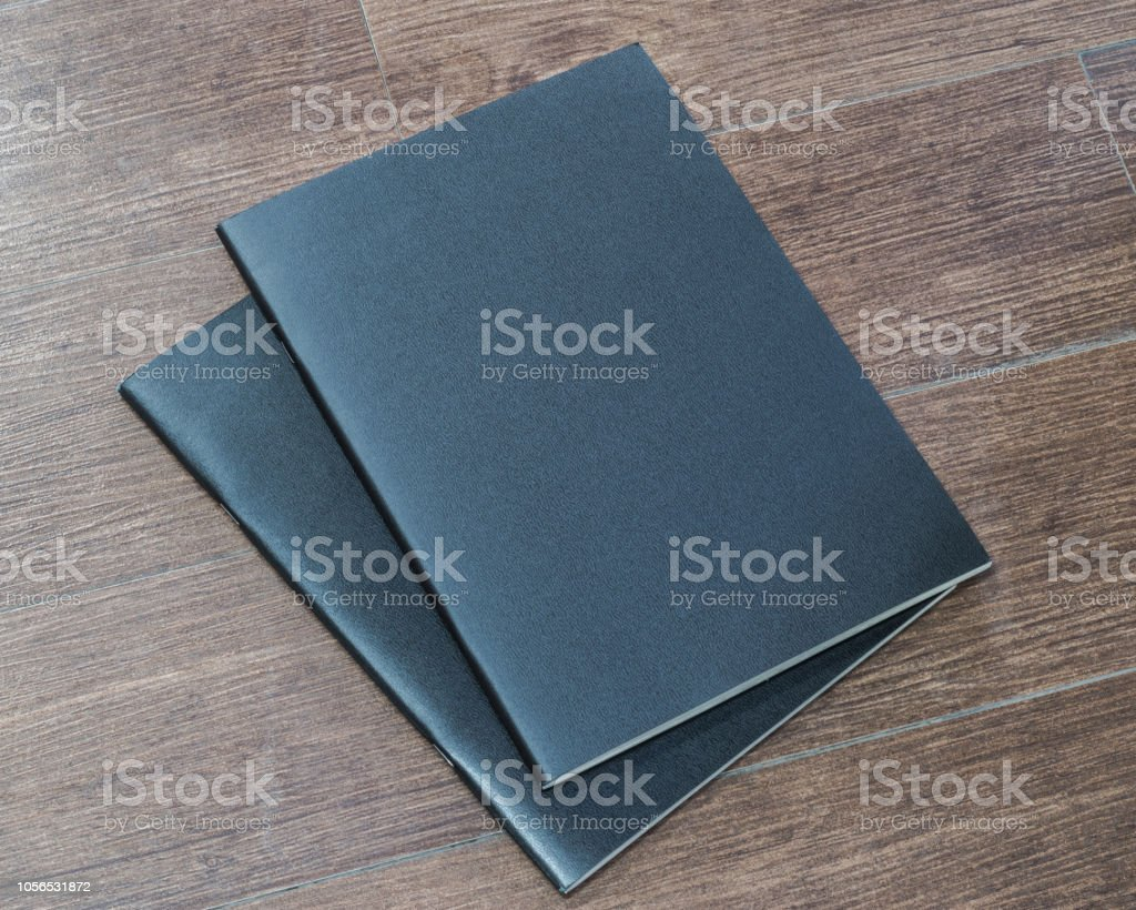 Book mockup blank black A4 leather cover for magazine, booklet, brochure, menu, diary mock-up design template on wooden table background stock photo