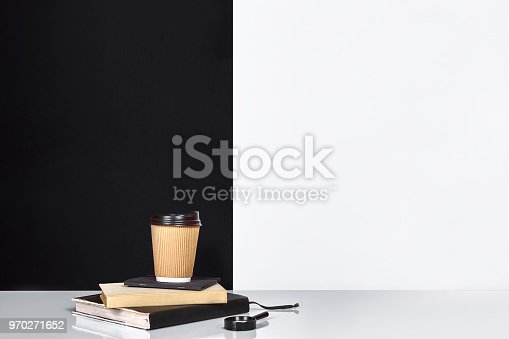 istock Book, notebook and cup of coffee, black and white wall 970271652