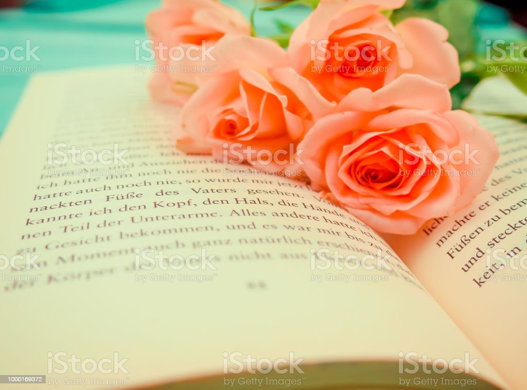 Book Novel In German Is Open On It Gentle Roses Reading Concept Of