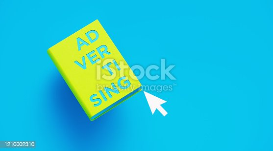 1140385944 istock photo Book of Advertising Over Blue Background 1210002310