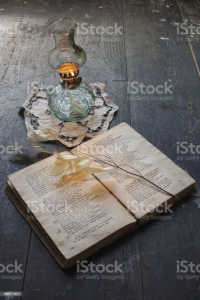 Book of poetry and ancient oil lamp royalty-free stock photo
