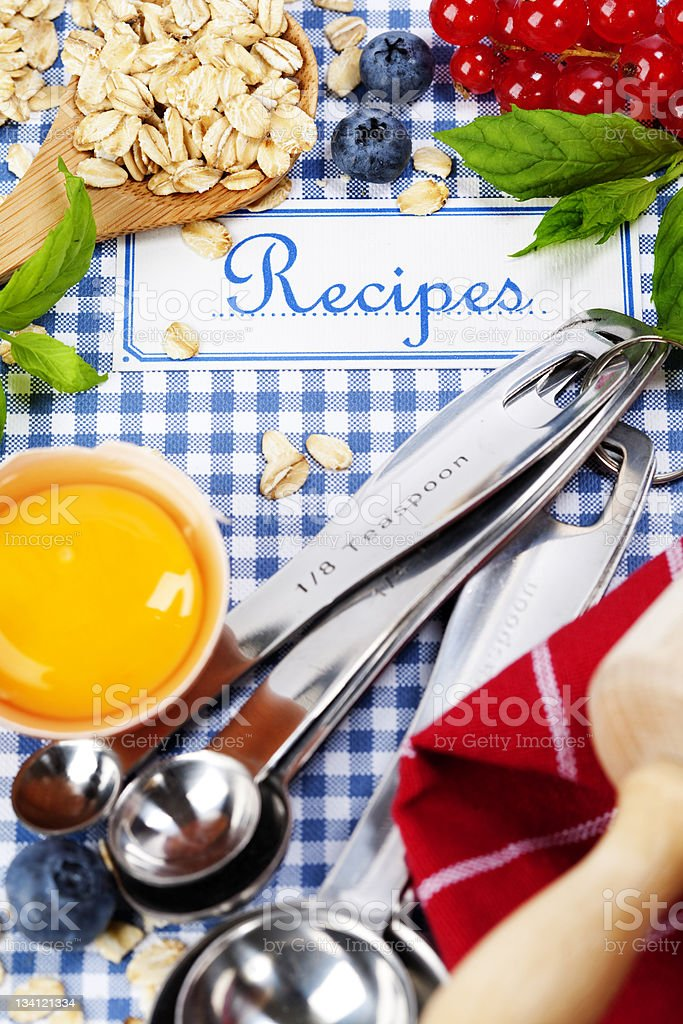 A book of recipes with cooking ingredients and utensils  stock photo