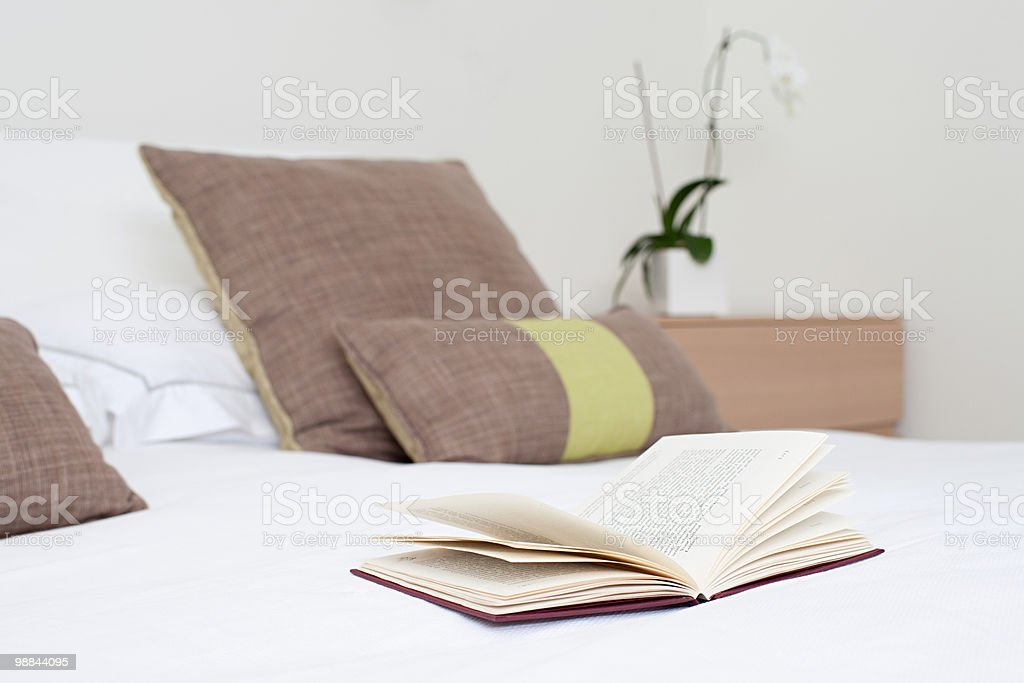 Book on a bed royalty-free stock photo